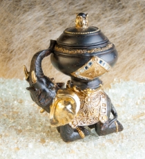 Elefant kniend mit Prachtgefäß, schwarz/gold